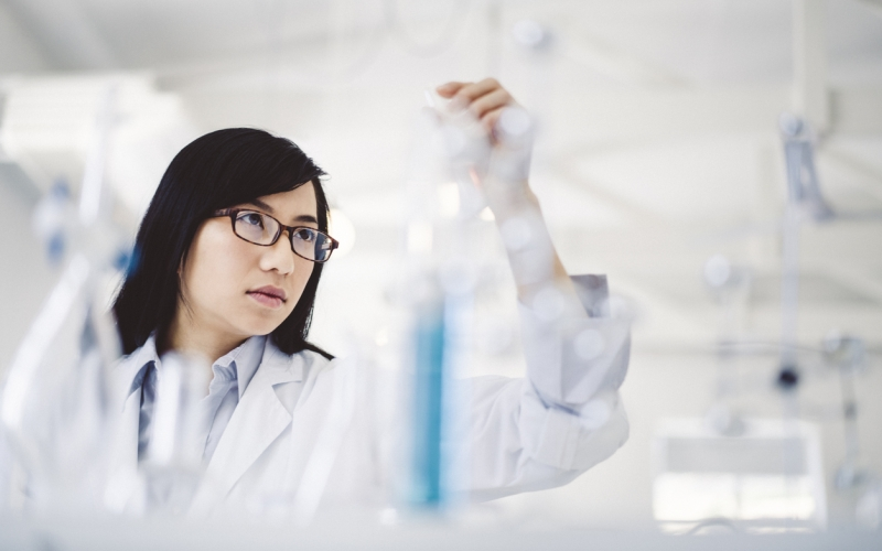 Female scientist analyzing sample in laboratory
